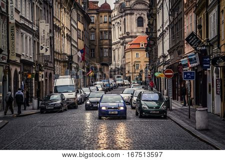 Prague, Czech Republic - 4 January 2008: Cars stopped at a pedestrian crossing on a street near the Prague Castle