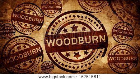 woodburn, vintage stamp on paper background