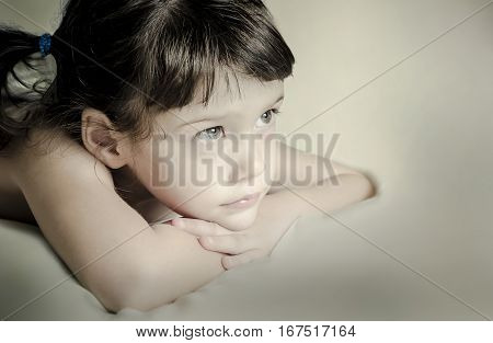 Portrait Of A Pretty Little Girl Is Daydreaming.