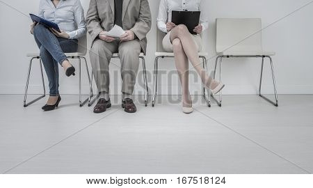 recruitment recruiting hire recruit hiring recruiter interview employment job human room stress stressful position young group formal work chair corporation corporate sitting concept - stock image