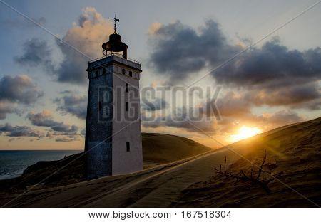 Sunrise at the abandoned lighthouse at Rubjerg Knude, Jutland, Denmark,