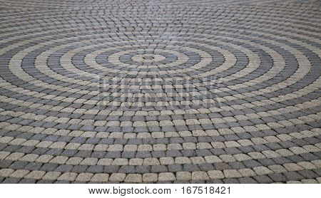 Tile Paving. Perspective. Small, square tiles laid in the form of a circle