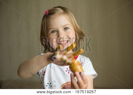 Little girl painting with her fingers. Selective focus