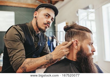 Barber Checking Symmetry Of Haircut