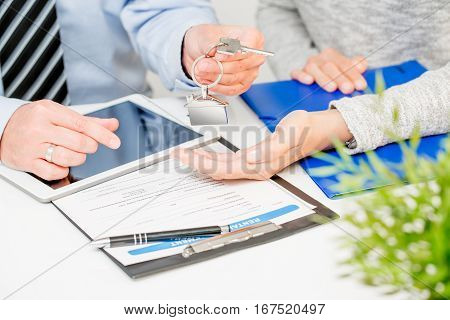 loan agent home key real estate realtor house keychain signature banking meeting - stock image