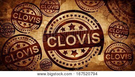 clovis, vintage stamp on paper background