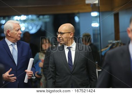 BUCHAREST ROMANIA - January 30 2017: Teodor Viorel Melescanu Romanian Minister of Foreign Affairs and Harlem Desir French Secretary of State for European Affairs speaks walk together before the press conference.