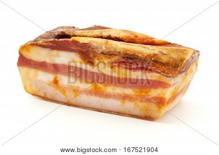 Slice of Calabrian pancetta on a white background