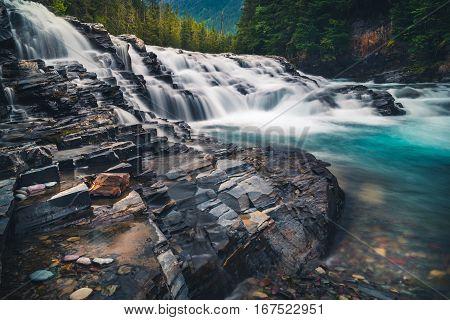 River cascading over rocks in Glacier National Park, Montana.