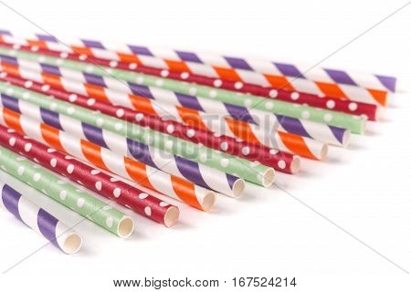 Colorful drinking striped straws isolated on white background.