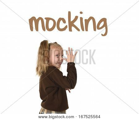 English language learning vocabulary school card with word mocking and sweet schoolgirl with pigtails playful and naughty taking tongue out wearing school uniform isolated on white