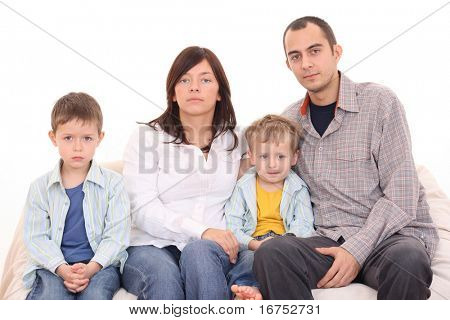 mother father and two sons on the sofa - family