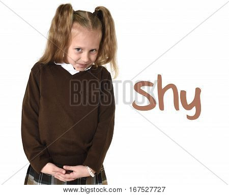 English language learning vocabulary school card with word shy and young sweet little schoolgirl with pigtails in school uniform shy and timid as if scared or overwhelmed isolated on white