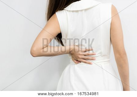 Young businesswoman having back pain from work. Office syndrome concept.