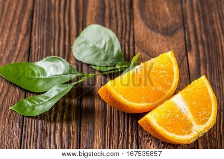 Sliced Orange On The Wooden Table