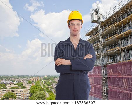 Construction worker with building and view over city