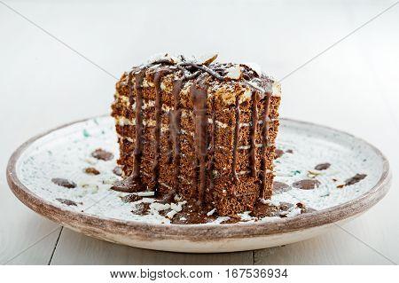 Delicious sweet chocolate Spartak cake on a rustic plate. Haute cuisine dessert. International food.