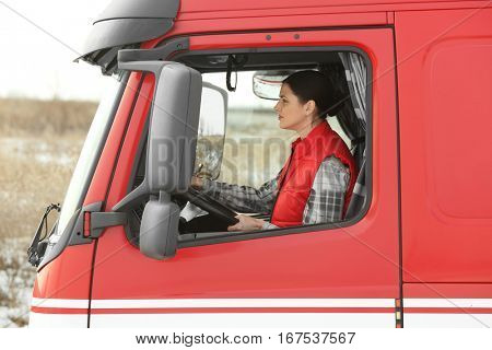 Young woman driving big modern truck