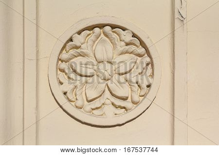 Bas-relief with a flower pattern on the wall. Architecture