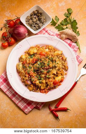 spicy barley risotto with chicken tomato capers and ginger