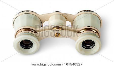 Old vintage pair of opera glasses horizontally isolated on white background
