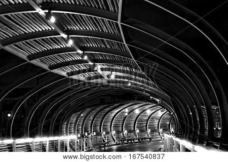 A covered walkway is captured at night.