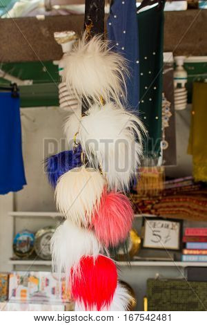 Set of pompoms of various colors for sale in the bazaar
