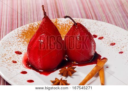 Sweet food pear poached in red wine