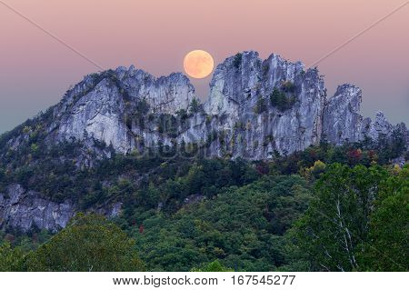 Composite of the supermoon over the rocky mountain top of Seneca Rocks in West Virginia