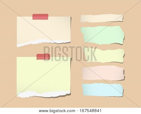 Torn different size white note, notebook, copybook paper sheets, strips stuck on orange background.