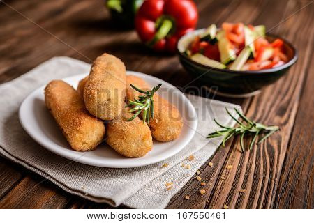 Chicken Croquettes Served With Vegetable Salad