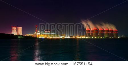 Night view of cooling towers of the Novovoronezh nuclear power plant from the cooling pool