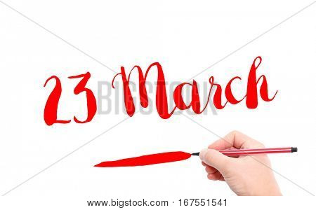 23 March written by hand on a white background