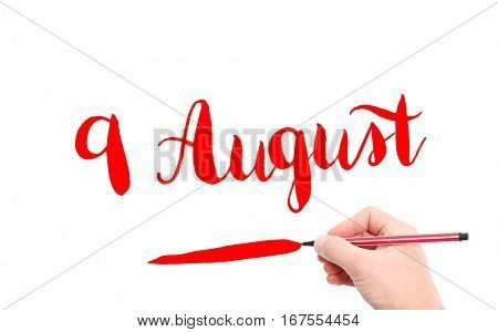 9 August written by hand on a white background