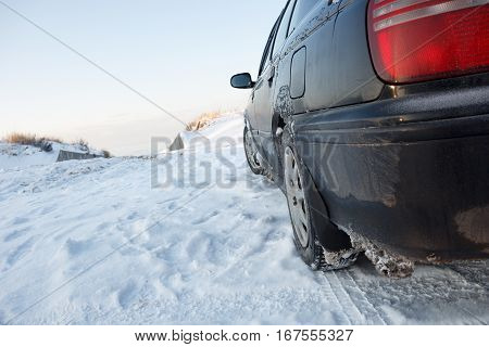 A car parked in a place with snow