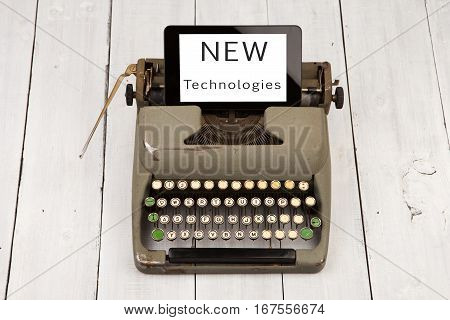 Old Typewriter And New Tablet Pc With Words