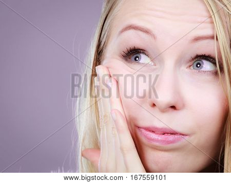 Young Teenager Woman Thinking With Hand On Cheek