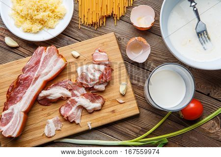 Photo of products for pasta carbonara on wooden table