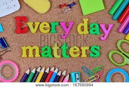Every day matters words on cork background