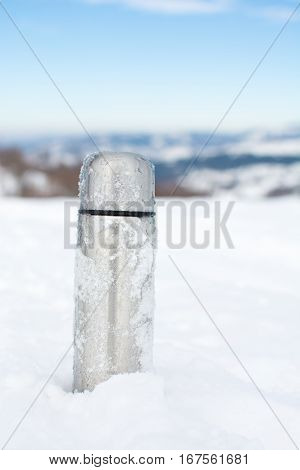 Metal Thermos In The Snow On A Mountain