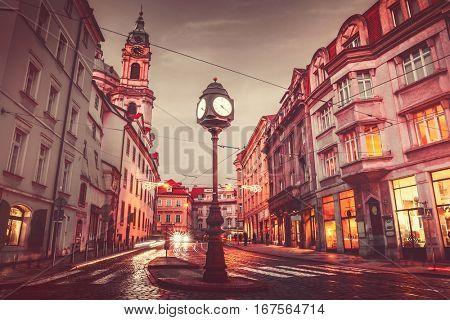 Czech Republic Prague square with old street lamp with clock dark evening sky retro vintage roofs