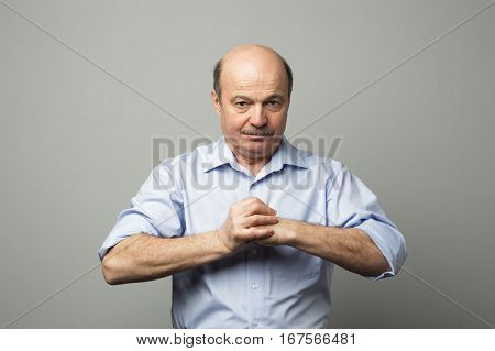 Man clenches his fists looking forward aggressively defending against enemies