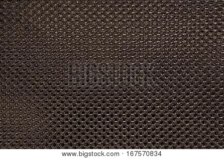 Brown fishnet cloth material as a texture background. Nylon texture pattern or nylon background for design with copy space for text or image.