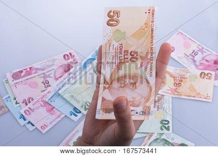 Hand Holding Turksh Lira Banknote  In Hand