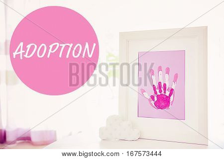 Adoption concept. Frame with family hands prints on table