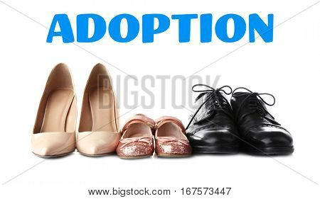 Adoption concept. Shoes of family on white background