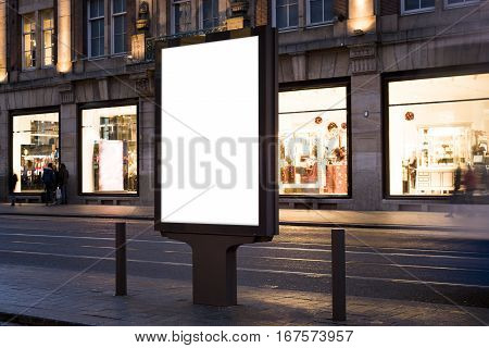 Outdoor kiosk advertising mockup in a shopping street