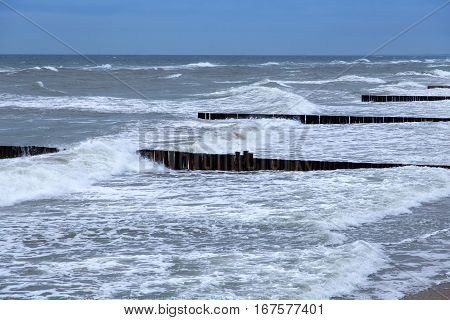 View of the Baltic Sea in the winter during a strong wind in overcast weather.