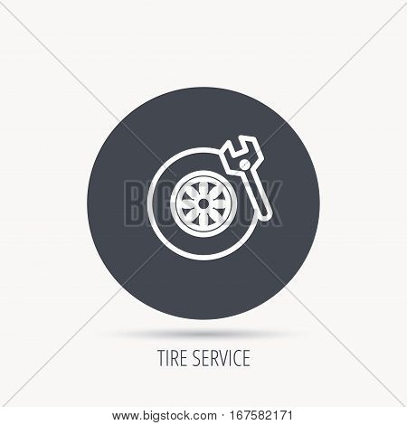 Tire service icon. Wheel and wrench key sign. Round web button with flat icon. Vector