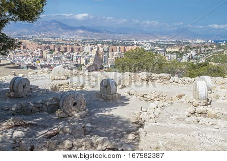 archeological remains in Santa Barbara castle with the city of alicante in the background
